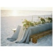 blue rectangular tablecloth used in a beach setting with decor