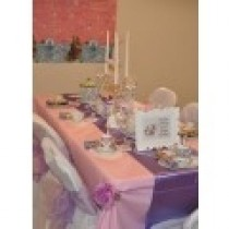 pink rectangular tablecloth with purple overlay and lilac chair bows for elegance