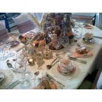 White Oval Spun Poly Table Cover Aurora