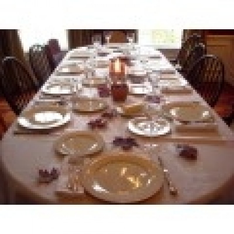 ... White Oval Tablecloth With Fall Decor For Holiday Party ...