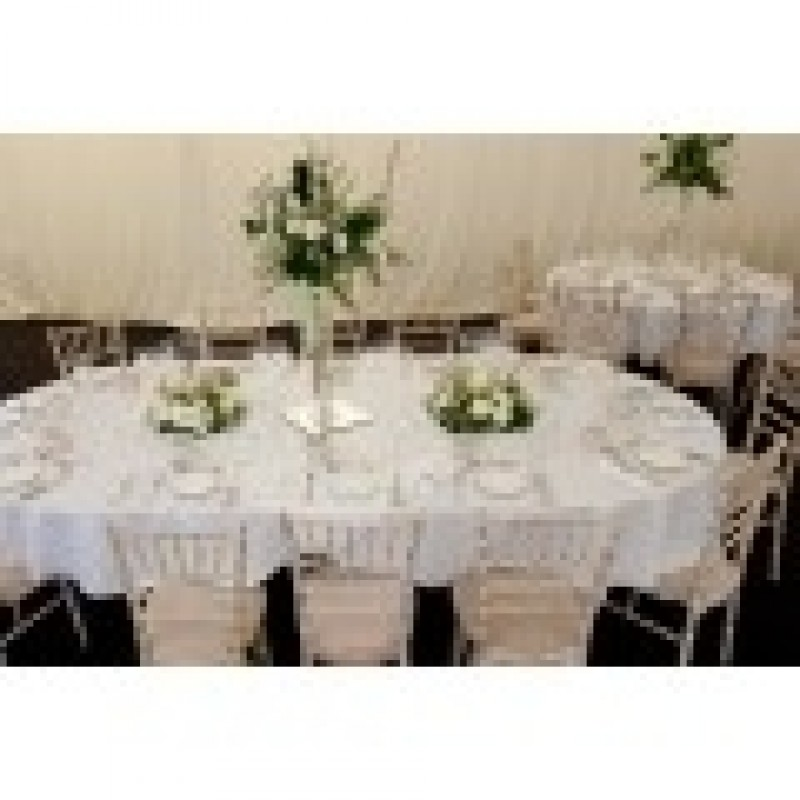 ... White Oval Tablecloth With White Floral Arrangements ...